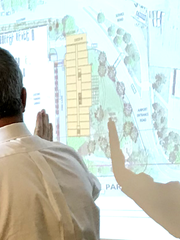 Architect Greg Rabideau shows plans for a proposed