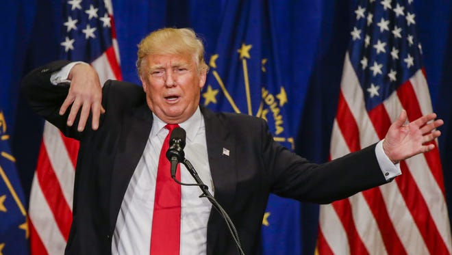 Businessman and Republican presidential candidate Donald Trump gestures as he speaks at a campaign rally at the Century Center in South Bend, Indiana, May 2, 2016.