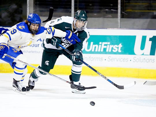 MSU's Travis Walsh of clears the puck away from Gage Torrel of Lake Superior State as Jake Hildebrand guards the net during the first period on Oct. 10 in Portland, Maine.