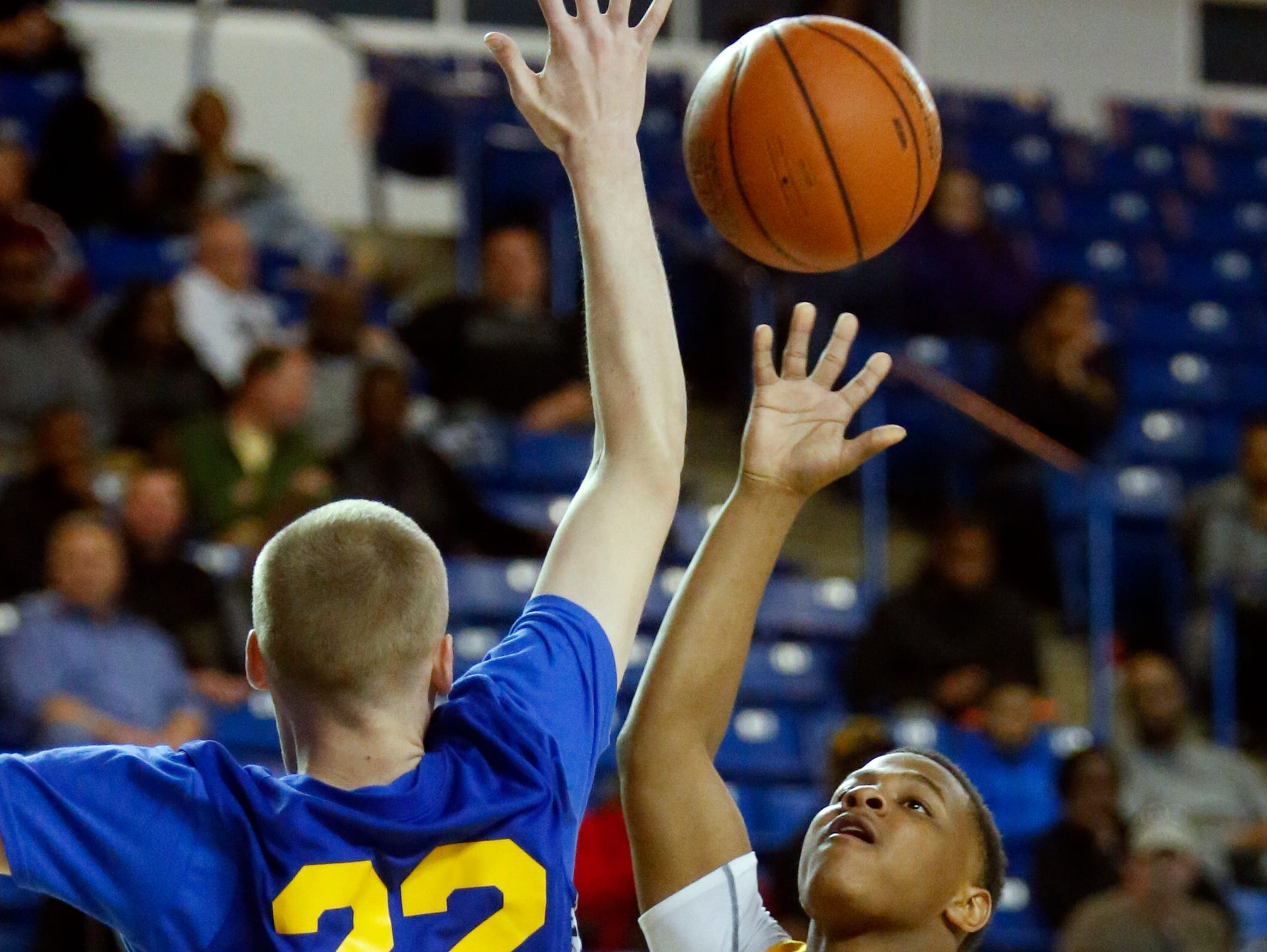 Blue's Joe McHugh of Concord (left) defends as Gold's Jaquan Hooks of Caesar Rodney drives in the first half of the Blue-Gold All-Star Basketball game at the Bob Carpenter Center Saturday.