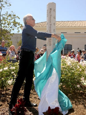 Dr. Steve Alff unveils a Peace Pole Sunday at the Camarillo Public Library.