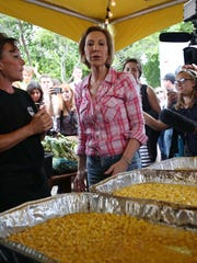 Carly Fiorina learns about the corn cooking process
