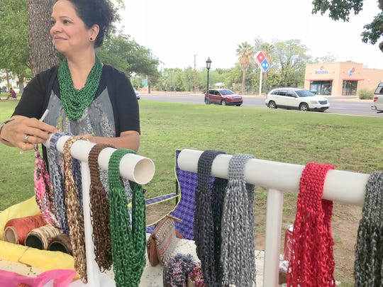 Sandra Magallanes saw brisk sales of her handmade body necklaces in an array of brightly colored yarns.
