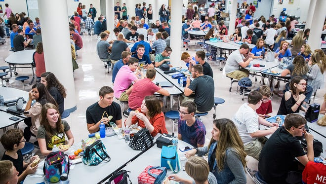 Students gather for lunch on the first day of school at Delta High School.