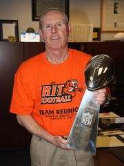 Giants coach Tom Coughlin wears the same shirt in his office that 42 of the men who played for him at RIT wore while watching the Giants defeat the Patriots in the Super Bowl to cap the 2007 season.