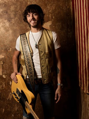"""Chris Janson charted his first hit song this summer with """"Buy Me a Boat."""""""