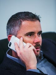 Head football coach Mike Norvell talks on the phone during National Signing Day in the Athletic Office Building at University of Memphis on Wednesday, Feb. 1, 2017.
