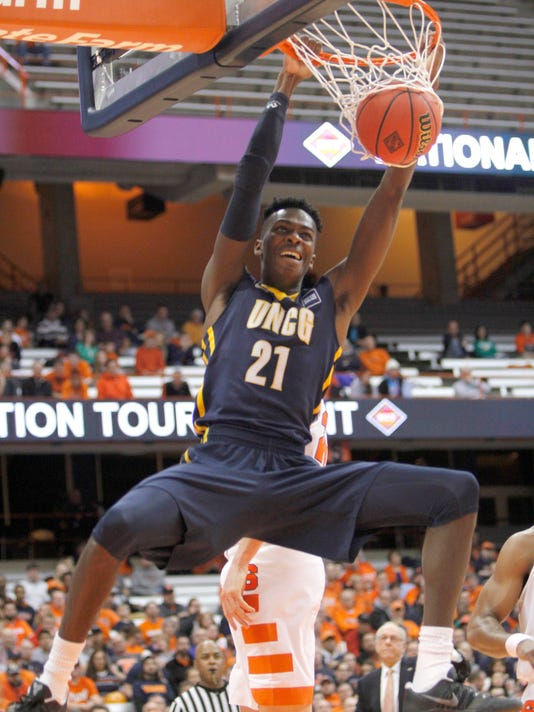 UNC Greensboro's James Dickey III dunks during the first half against Syracuse during an NCAA college basketball game in the NIT, in Syracuse, N.Y., Wednesday, March 15, 2017. (AP Photo/Nick Lisi)