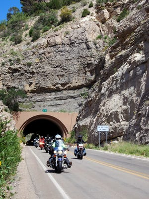 Participants in the 2014 Ride for the 4-H Clover motorcycle tour ride through the tunnel on U.S. 82 between Cloudcroft and Alamogordo on the second day of the Aug. 23-24 event.
