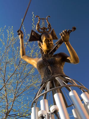 "The sculpture 'Muse-IC"" by Sioux Falls artists Lee Leuning and Sherri Treeby, currently featured in SculptureWalk in downtown Sioux Falls."