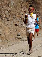 In buoyant strides, this racer's determined smile emanated