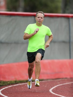 Doug Covert runs the 400-meter dash on the Florida Senior Games track.