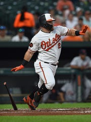 Baltimore Orioles' DJ Stewart races to first on a single against the Detroit Tigers in the fourth inning of a baseball game, Tuesday, May 28, 2019, in Baltimore. (AP Photo/Gail Burton)
