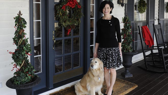 Bobbi Noe with dog, Ellie, on the front porch of the Welsh Hills Inn in Granville. The inn was recently named the No. 3 bed and breakfast/inn in the country by TripAdvisor Traveler's Choice Awards for 2016. It was named the No. 1 B&B in the US last year.