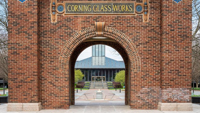 The entrance to Corning Inc. Global Headquarters in Corning is seen through the historic arch that bears the company's former name.
