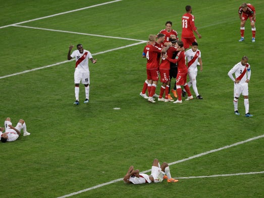 Denmark players celebrate after defeating Peru.