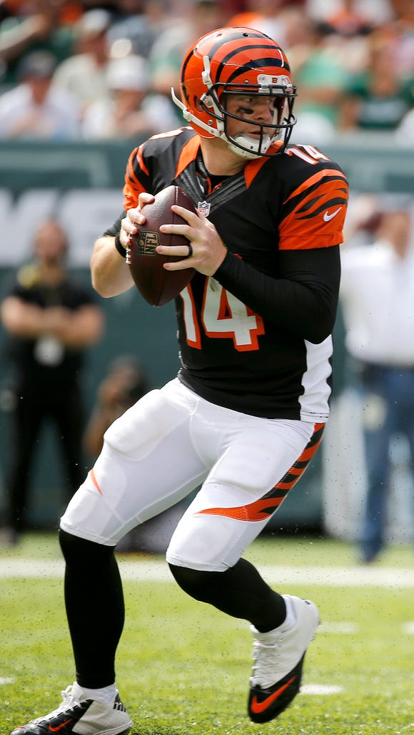 Cincinnati Bengals quarterback Andy Dalton (14) looks to make a pass in the 2nd quarter against the Jets at MetLife Stadium in East Rutherford, New Jersey, Sunday, September 11, 2016.