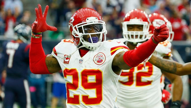 Eric Berry (29) of the Kansas City Chiefs celebrates his first-quarter interception against the Houston Texans during the AFC playoff game at NRG Stadium in Houston on Saturday. The Chiefs advanced with a 30-0 victory.