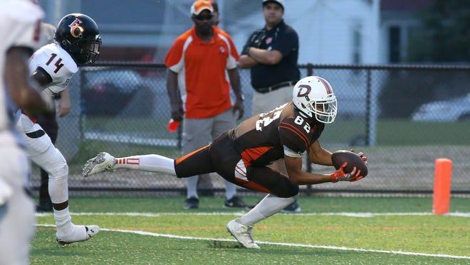 Jordan Watkins (82) catches  the ball for DeSales during action between Fern Creek and DeSales High Schools. Sept. 16, 2016