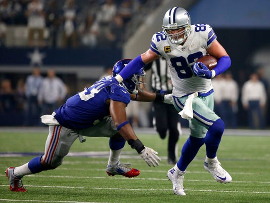FILE - In this Sunday, Sept. 10, 2017, file photo, New York Giants linebacker B.J. Goodson (93) gives chase as Dallas Cowboys tight end Jason Witten (82) gains yardage after catching a pass in the first half of an NFL football game in Arlington, Texas. Cowboys tight end Jason Witten leads the NFL with 17 catches and has moved into fourth place on the career list with 1,106 receptions.  (AP Photo/Ron Jenkins, File)