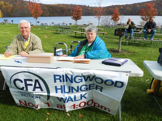 Ringwood Hunger Walk Treasurer Ray McCarthy and fellow volunteer Regina Kirby collecting donations during the fundraiser held on Nov. 4, 2015 at Shepherd Lake.