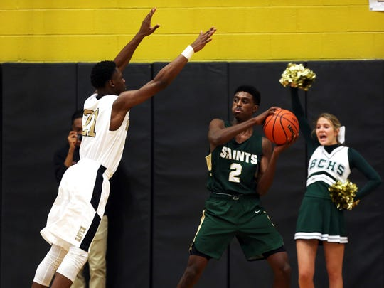 January 9, 2018 - Whitehaven's Devine Owens (21) obscures the view for Briarcrest's Cedric Henderson (2) as he tries to find an open teammate during the game at Whitehaven High School on Tuesday night. Briarcrest defeated Whitehaven 60-56.