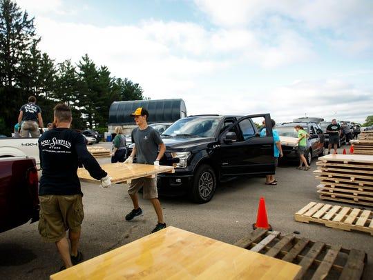 Neil Brecheisen and Morgan Beadlescomb load pieces