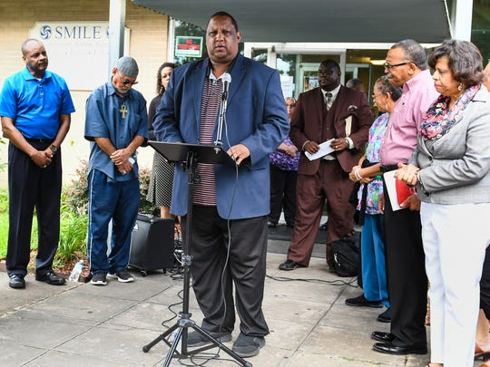 SMILE CEO Chris Williams speaking at a prayer vigil