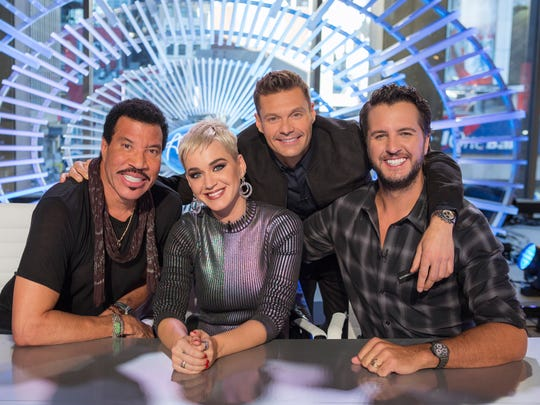 Host Ryan Seacrest, second from right, an 'American