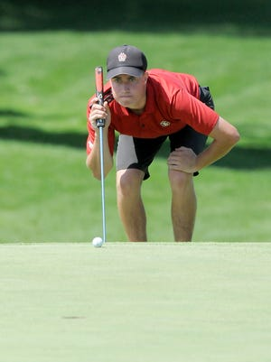 Matt Tolan of Eau Claire lines up a putt Thursday during the final round of the State Amateur  at Oconomowoc Golf Club.