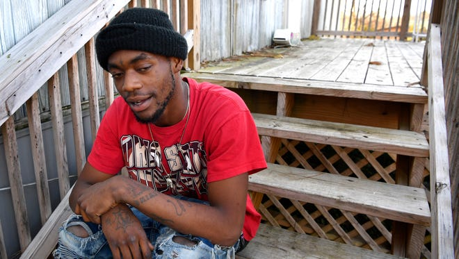 Sitting on the porch of the home where he grew up, just outside the housing projects, a teenager that refused to give his name, talks about how the local police treat the residents of his neighborhood with little respect Friday Dec. 1, 2017, in Springfield, TN