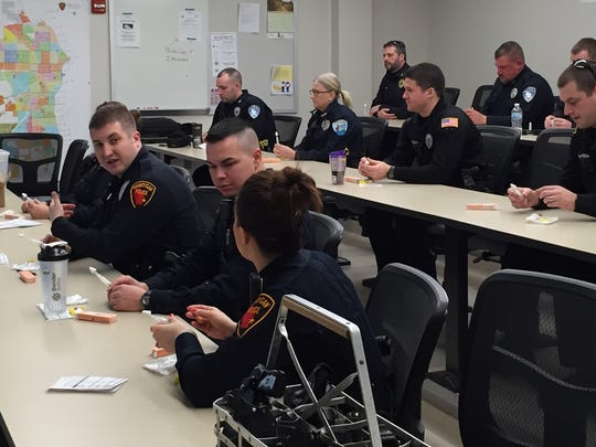 Law enforcement officers receive training in the use of Narcan on March 21, which is used to treat heroin overdoses. Approximately 185 officers across the county are being trained in its use.