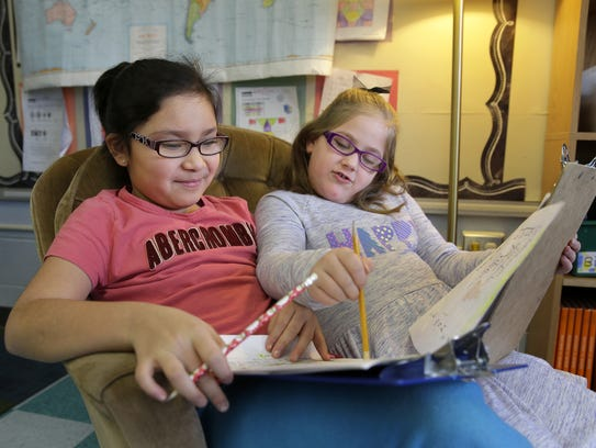 Debra Flores and Avalyn Julius, both second-graders,