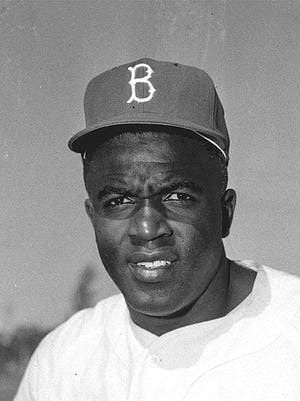 Jackie Robinson, the Brooklyn Dodgers infielder is seen at spring training in Vero Beach, Florida, in March 1956. When the Major League Baseball season begins in April, it will mark the 70th anniversary of when Robinson broke baseball's color barrier.