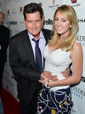 Charlie Sheen and then-fiance Scottine Rossi, in Toronto in June 2014.