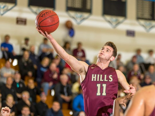 Joe Cerone of Wayne Hills extends to the basket during the Passaic County boys basketball tournament final en route to an overtime win over the Paterson school at Wayne Valley High School on Saturday, Feb. 24, 2018.
