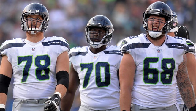 Much depends on whether Seahawks linemen Luke Joeckel (78), Rees Odhiambo (70) and center Justin Britt (68) can keep quarterback Russell Wilson upright and healthy this season.