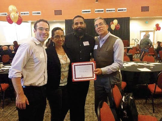 David Greenberg, at left, poses with fellow Ngage New Mexico staffers Lucia Carmona, Michael Radtke and Executive Director Frank Lopez after being recognized at a New Mexico State University community celebration in 2015.