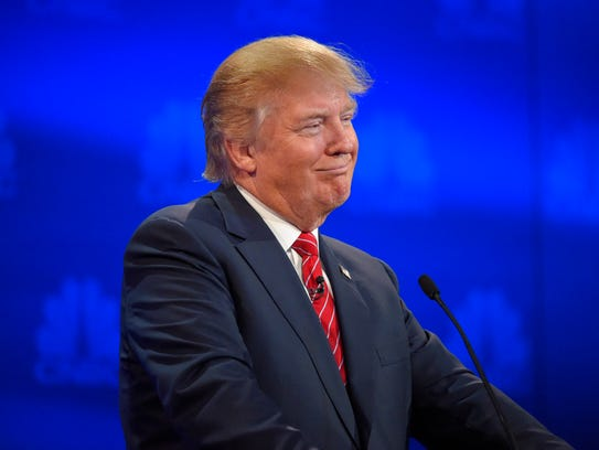 Donald Trump smiles during the CNBC Republican presidential