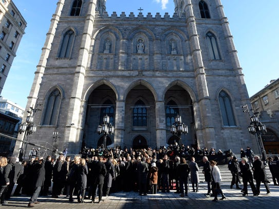 People gather at Notre-Dame Basilica in Montreal, on