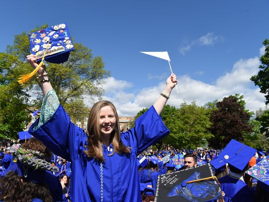 Jeanne O'Connor, a Metals major stands on her seat