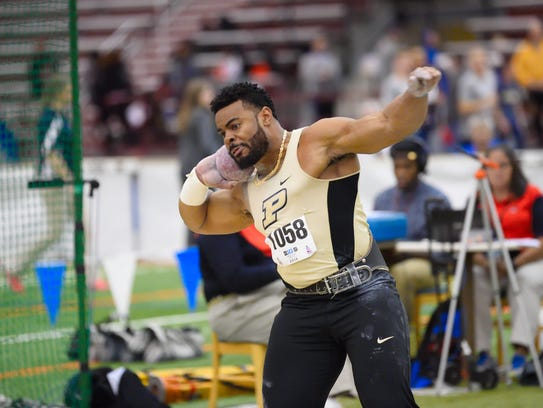Former Purdue All-American Chukwuebuka Enekwechi is now coaching throwers at West Lafayette High School.