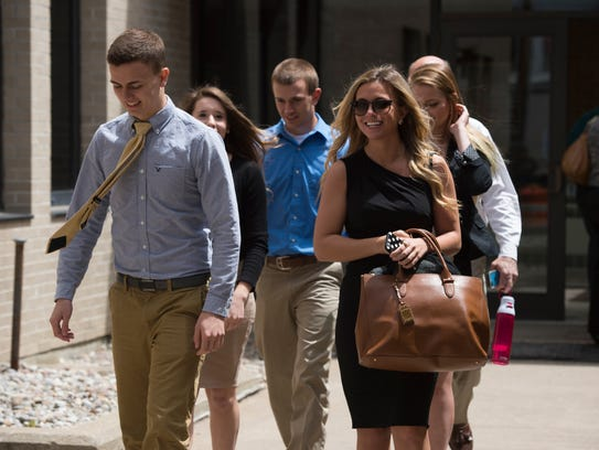 The Harris family leaves Schoharie County Court on