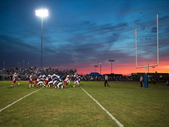 The sun sets on Friday night's football game at Cocalico