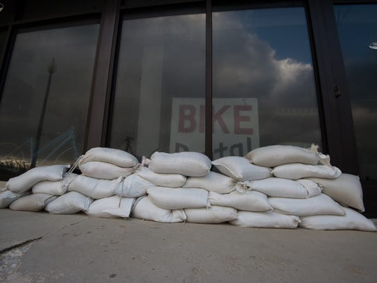 View of sand bags in front of Atlantic Cycles store