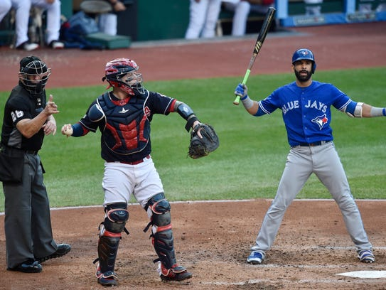 Jose Bautista reacts after a called strike against