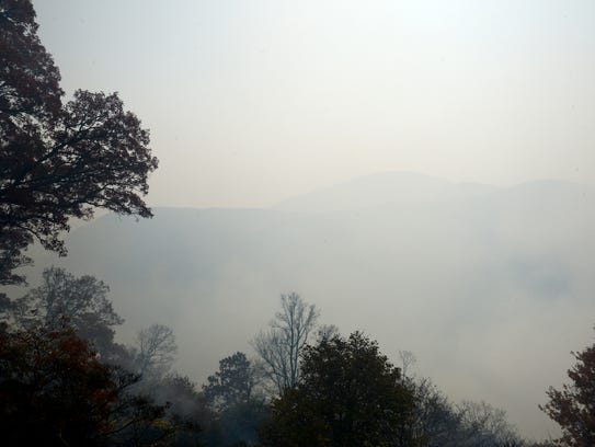 Smoke from the Party Rock fire fills the air obscures