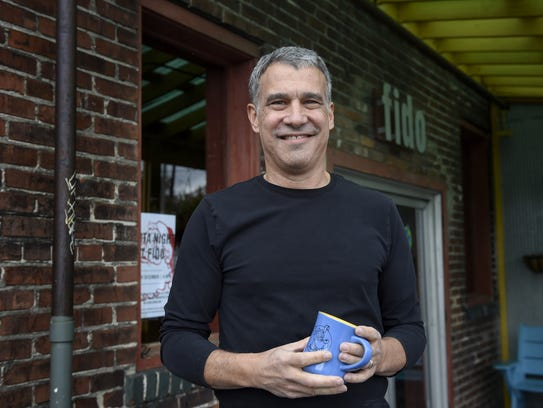 Bob Bernstein stands outside his restaurant Fido on