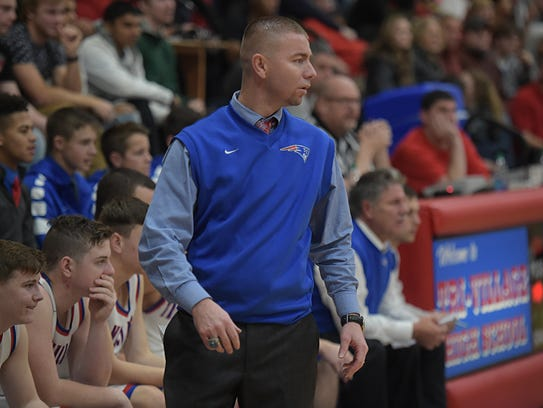 Tri-Village basketball Coach Josh Sagester reacts during