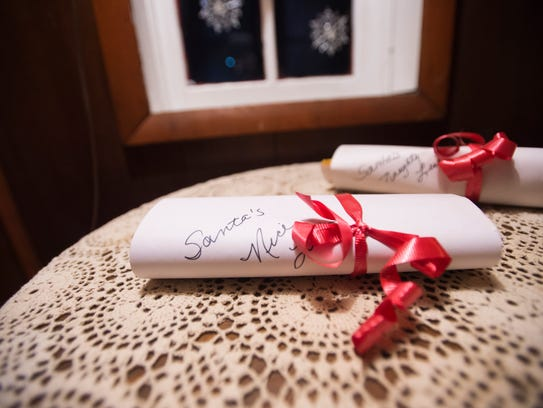 Naughty and nice lists sits on a table at Santa's headquarters